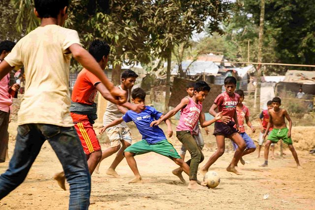 Rohingya refugee children playing football in Cox's Bazar