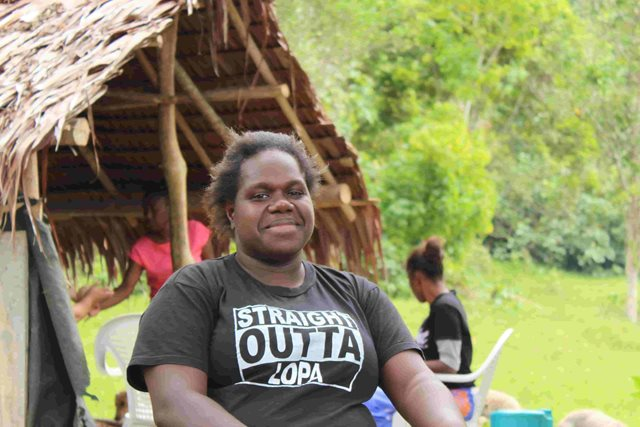 Anicka, a young leader making community change in Vanuatu, smiles at the camera