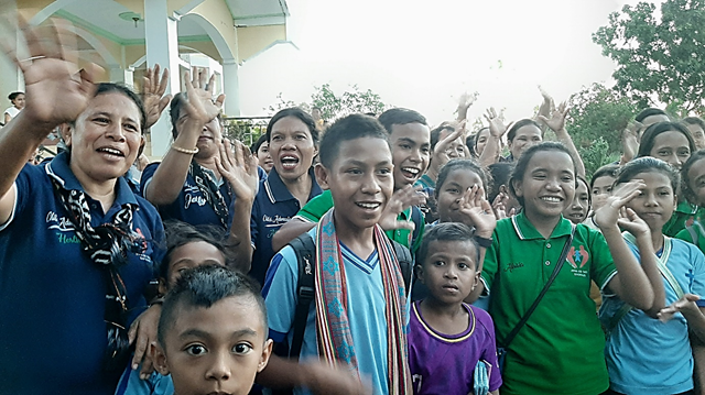 Sponsored children and the local church wave goodbye from Indonesia!