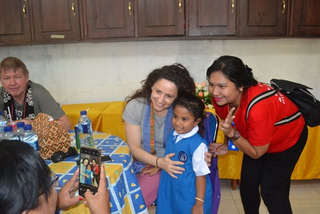 Victoria Hanna from Tearfund NZ poses for a photo with a Compassion staff and a sponsored child in Indonesia