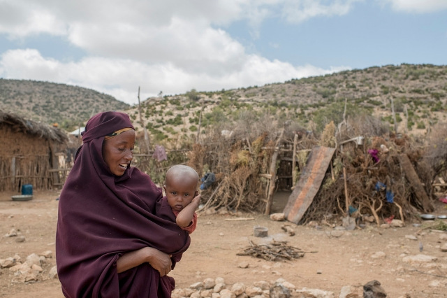 A-mother-holds-her-baby-during-the-Somalia-drought,-2017.jpg