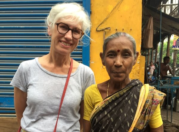 New Zealander Ruby Duncan smiles to camera standing beside an Indian woman