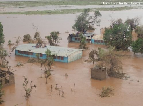 Families-huddle-together-on-their-rooves-to-escape-the-raging-flood-after-Cyclone-Idai.jpg