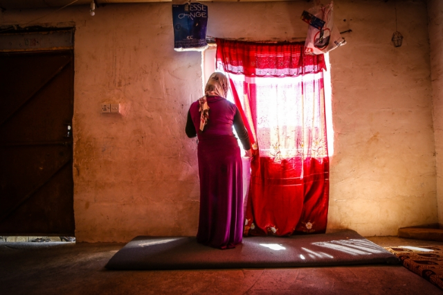 Golle is photographed inside her home within a refugee camp in Northern Iraq after escaping with her four children when Isis invaded her village.