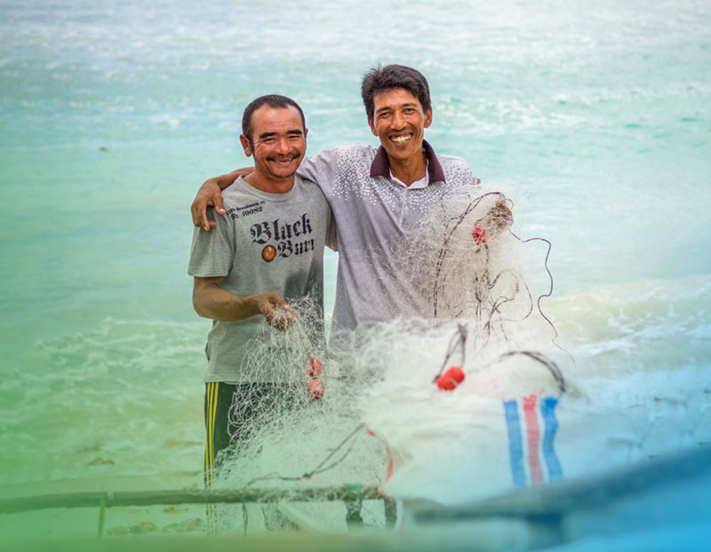 Warisi pictured with fellow fisherman, Feroni, on Hibala Island, Indonesia.